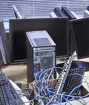 Picture of a desktop pc and monitor on the floor.